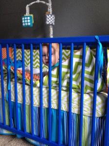 Hudson in his crib